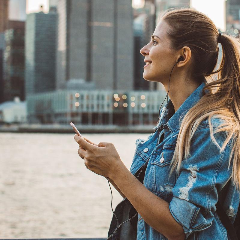 Insight Womanlisteningtoheadphonesincity Square